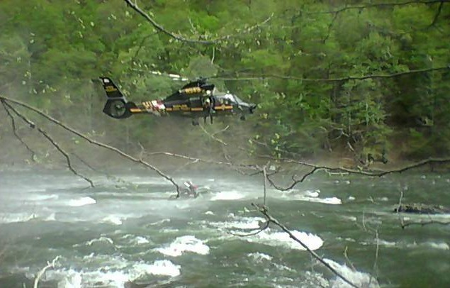 A Maryland State Police helicopter rescues two fishermen stranded on the South Branch of the Potomac near the Hardy-Hampshire County line