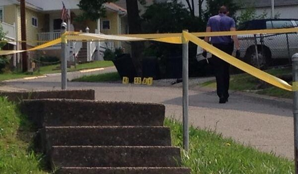 Police marked the spot where 7 shots were fired Tuesday morning.