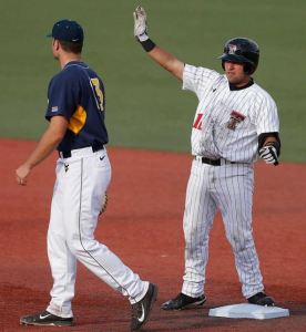 Texas Tech's Eric Gutierrez celebrates his game-tying RBI double in the seventh against West Virginia. The Red Raiders prevailed 4-3 in 11 innings.