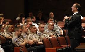Motivational speaker and former La. State Trooper Bobby Smith speaks to first responders around the world. He was in Charleston Wednesday.