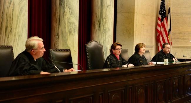 Members of the state Supreme Court (L to R) Menis Ketchum, Robin Davis, Margaret Workman and Allen Loughry listened to arguments on the Plants case Monday.