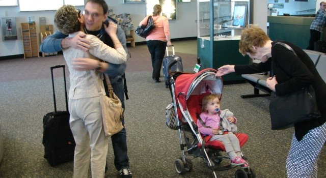 West Virginia native Ben Richardson of Brooklyn, New York, hugs his mother upon his holiday weekend arrival at Yeager Airport in Charleston. He was happy to get back to the Mountain State after some holiday travel delays.