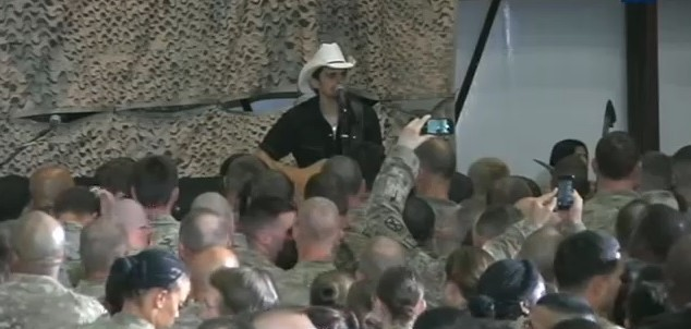 Brad Paisley performed for military members stationed in Afghanistan during a surprise trip from President Barack Obama on Sunday.