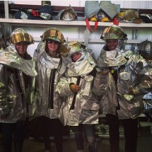 Lambert (third from left) and friends donned fire suits at the North Central West Virginia Airport Tuesday evening. She posted the picture on Instagram.