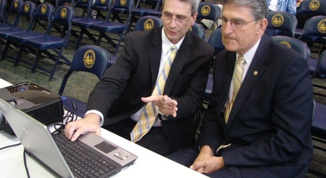 U.S. Senator Joe Manchin (right) receives instruction from state Director of Archives and History Joe Geiger on how to access the new online search took.