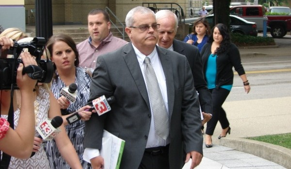 Former Mingo County Circuit Judge Michael Thornsbury was surrounded by reporters when he entered the federal courthouse in Charleston Monday for his sentencing.