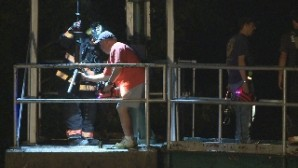 Volunteer firefighters from Ceredo slowly hoist two victims from a deep shaft in the town's flood wall.