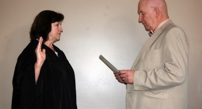 New Mingo County Circuit Judge Mikki Thompson takes ceremonial oath of office from Senior Status Judge John Cummings Thursday.