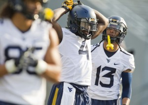 Wendell Smallwood (4) and Andrew Buie are two components in West Virginia's deep and diverse running backs unit.