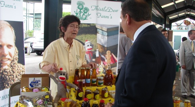 Ellie Conlon with ThistleDew Farm in Proctor talked with Gov. Earl Ray Tomblin at Tuesday's launch of Bon Appetit Appalachia at Charleston's Capitol Market.