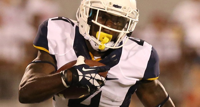WVU running back Wendell Smallwood, who was extradited to Delaware and accused of witness intimidation in a murder case, saw the charges dropped Tuesday.