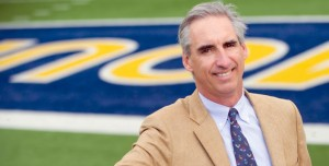 Oliver Luck says he expects West Virginia's football team to be better in 2014, though that may not lead to an increase in wins.