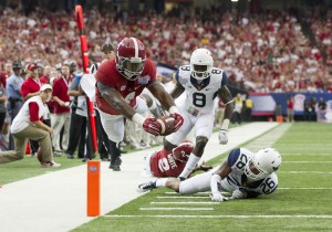T.J., Yeldon dives for one of his two touchdowns in Alabama's 33-23 win over West Virginia.