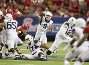 """Sacked twice but rarely pressured on 47 drop-backs against Alabama, quarteback Clint Trickett said West Virginia's offensive linemen """"played their asses off."""""""