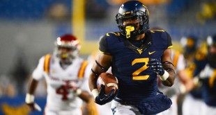 West Virginia's Dreamius Smith rumbles 45 yards against Iowa State during the final game of the 2013 season.