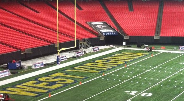 Georgia Dome crews were finishing painting West Virginia in the end zone Friday afternoon.