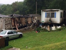 Monday morning flames ripped through 2 mobile homes on Jasper Lane in Sophia. The blaze claimed the life of a resident and injured a few volunteer firefighters.