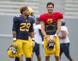 West Virginia's Dustin Garrison (29) and Clint Trickett