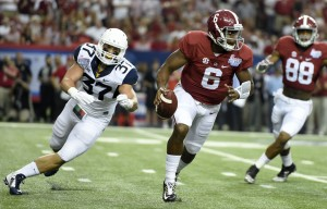 West Virginia's Wes Tonkery (37) pursues Alabama quarterback Blake Sims