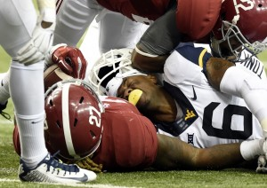 West Virginia's Dravon Henry loses his helmet after tackling Alabama running back Derrick Henry. The freshman safety played 81 of WVU's 82 defensive snaps.