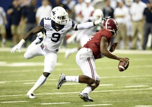 West Virginia blitzer K.J. Dillon whiffs on Alabama quarterback Blake Sims during the Mountaineers' 33-23 loss.