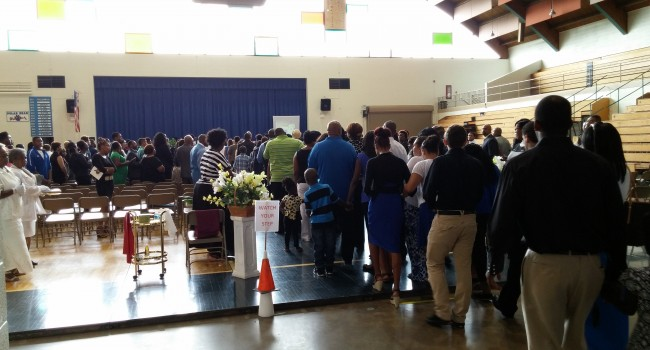A large crowd files in to the Woody Williams Armory in Fairmont Friday for the Celebration of Life services for Devante' Waites.