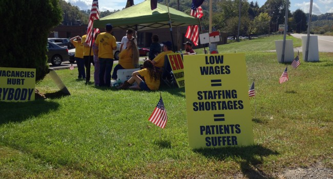 Picketers gather near William R. Sharpe, Jr. Hospital in Weston, W.Va.