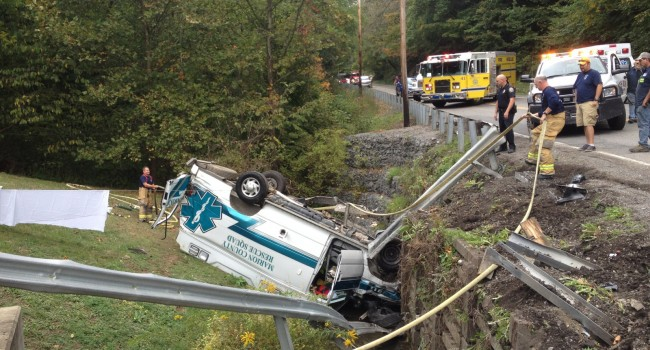 This Marion County ambulance landed on its top after a collision on U.S. Route 250 and Barrackville Road Monday afternoon.