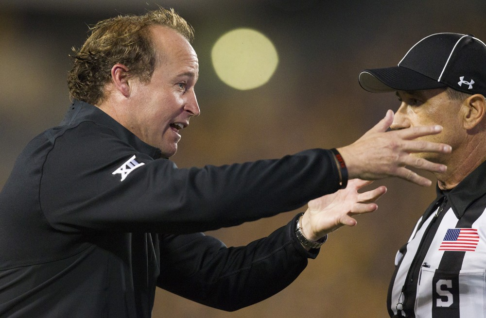 Dana Holgorsen argues with an official Saturday night.