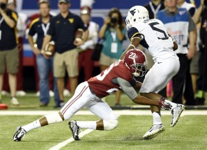West Virginia's Mario Alford made Alabama's Jabriel Washington miss at the outset of a 100-yard kick return.