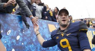 Clint Trickett celebrates with West Virginia fans after Saturday's 41-27 upset of Baylor.