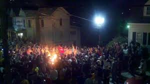 Crowds set fires, hurled bottles and tried to flip vehicles in several Morgantown neighborhoods after West Virginia upset No. 4 Baylor.