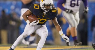 WVU wide receiver Jordan Thompson catches a pass during the first half against Kansas State.