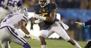 WVU wide receiver Mario Alford catches a pass during the first half against Kansas State.