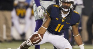 WVU wide receiver Kevin White catches a pass during the second half.