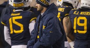 West Virginia quarterback Clint Trickett spent the final minutes of the Kansas State game on the sideline after suffering a concussion.