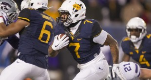 WVU running back Rushel Shell runs the ball in the second half against Kansas State.