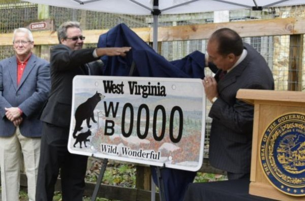 Governor Earl Ray Tomblin joins Department of Transportation Secretary Paul Mattox to unveil the third and final license plate in a three-part series, celebrating West Virginia's native wildlife.