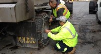 DOH crews were putting chains on snow plows Tuesday.