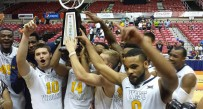 West Virginia celebrated the Puerto Rico Tip-Off championship and a 5-0 start after upsetting No. 17 Connecticut on Sunday.