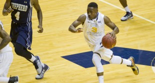 West Virginia's Juwan Staten on the move against Shepherd.