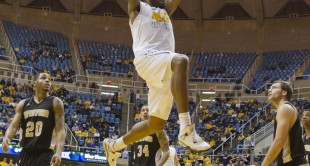 West Virginia Mountaineers forward Elijah Macon (45) dunks against the Wofford terriers during the second half at the WVU Coliseum.