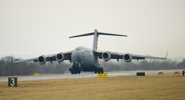 The front wheels of a C-17 Globemaster III lift off the runway at the 167th Airlift Wing, West Virginia Air National Guard base in Martinsburg Dec. 18, marking the first training flight for the aircraft at the 167th Airlift Wing.