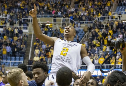 West Virginia Mountaineers guard Jevon Carter (2) celebrates beating TCU in Morgantown.