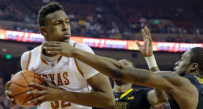 Texas freshman Myles Turner finished with 16 points and seven rebounds in a 77-50 win over West Virginia.