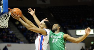 Louisiana Tech's Xavian Stapleton drives past Marshall's JP Kambola.