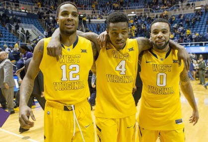 West Virginia Mountaineers guard Tarik Phillip (12), West Virginia Mountaineers guard Daxter Miles Jr. (4) and West Virginia Mountaineers guard Jaysean Paige (0) celebrate after beating Kansas State in Morgantown.