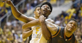 West Virginia Mountaineers forward Devin Williams (5) tries to rebound a foul shot against the Texas Longhorns during the second half at the WVU Coliseum.