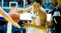 Averee Fields finished with 22 points and 12 rebounds as West Virginia edged Villanova 75-70 in overtime in the WNIT quarterfinals.