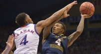 West Virginia's Daxter Miles scored 23 points but Kansas rallied to win in overtime.
